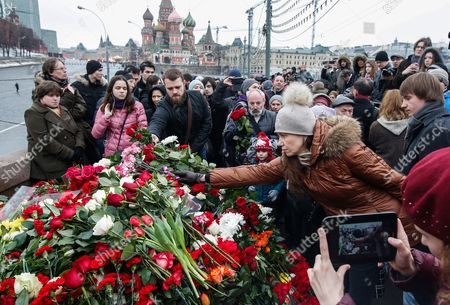 People Leave Flowers at the Site of the Killing of Russian Opposition Leader Boris Nemtsov in Central Moscow Russia 28 February 2015 Russian Opposition Leader Boris Nemtsov was Shot Dead From a Passing Car on the Bolshoy Kammeny Bridge in Central Moscow Late in the Evening of 27 February 2015 Nemtsov who Served As a Deputy Prime Minister Under Boris Yeltsin Had Been a Constant Critic of President Vladimir Putin Since He Came to Power in 2000 Since 2013 Nemtsov was a Member of the Parliament Representing the Yaroslavl Region North of Moscow Russian Federation Moscow