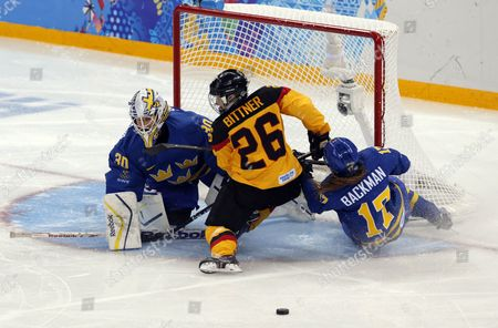 Monika Bittner (c) of Germany Fights For the Puck with Sweden Player Linnea Backman (r) and Goalkeeper Kim Martin Hasson (l) During the Group B Match of the Ice Hockey Tournament at the Sochi 2014 Olympic Games Sochi Russia 11 February 2014 Russian Federation Sochi