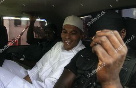 Stock Image of A Photograph Made Available 24 March 2015 Shows the Son of a Former Senegalese President Abdoulaye Wade Karim Wade Being Escorted by Police to the First Day of His Trial in Dakar Senegal 03 July 2014 Karim Wade was Sentenced to Six Years in Prison For Embezzling Public Funds on 23 March 2015 Karim Wade was Also Handed a Fine of 138 Billion Cfa Franc (228 Million Us Dollars) Wade 46 who Held Several Ministerial Portfolios Dealing with Finance During His Father's Presidency was Charged with 'Illicit Enrichment During That Time ' Senegal Dakar