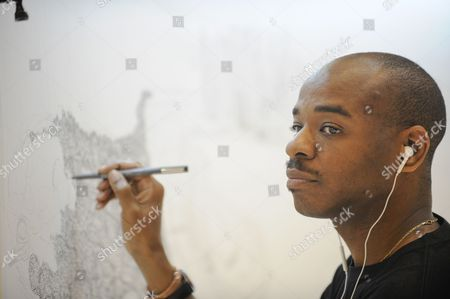 British Artist Stephen Wiltshire Glances to the Side While Sketching a Panorama of the Singapore Skyline at the Paragon Shopping Mall in Singapore 16 July 2014 Drawing Only From His Memory the Autistic Artist Has Completed Panoramas of Other Famous Cities Such As London New York and Rio De Janeiro the Finished Piece of Singapore Which Will Take Wiltshire Three Days to Complete Will Be Presented to President Tony Tan Keng Yam As a Gift For the 50th Anniversary of Singapore Singapore Singapore