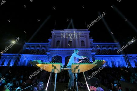 Us Musician William Close Plays His Musical Invention 'Earth Harp' in Front of the National Museum in Singapore 23 August 2014 the Earth Harp Works by Using Strings Attached to Its Surrounding Environment in This Case the Structure of the National Museum in Singapore the Singapore Night Festival 2014 Runs Over Two Weekends From 22 to 30 August and Features a Range of Musical Performances and Lighting Installations From Both Local and International Artists Epa/wallace Woon Singapore Singapore