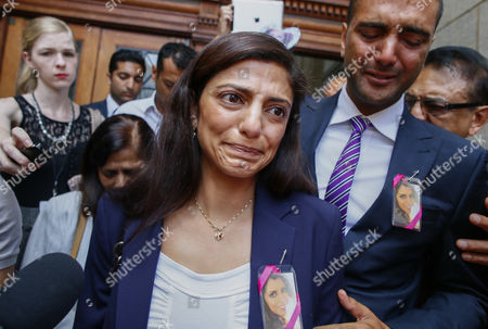 Ami Denborg (c) Sister of Anni Dewani Weeps As She Walks Away After Making a Statement Expressing the Familys Shock at the South African Justice System As She Stands with Anish Hindocha (2-r) Brother of Anni Dewani and Father Vinod Hindocha (r) at the Western Cape High Court Cape Town South Africa 08 December 2014 Judge Jeanette Traverso Dismissed the Case Against British Businessman Shrien Dewani who was Accused of Masterminding the Murder of His Wife Anni During a Staged Car-jacking on Their 2010 Honeymoon Judge Traverso Said the Evidence Presented by the Prosecution Fell 'Far Below the Threshold' of what a Reasonable Court Could Convict on South Africa Cape Town