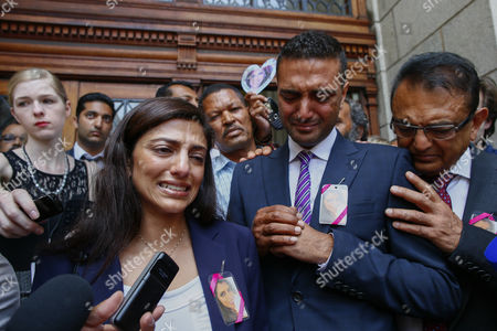 Ami Denborg (l) Sister of Anni Dewani Weeps As She Makes a Statement Expressing the Familys Shock at the South African Justice System As She Stands with Anish Hindocha (c) Brother of Anni Dewani and Father Vinod Hindocha (r) at the Western Cape High Court Cape Town South Africa 08 December 2014 Judge Jeanette Traverso Dismissed the Case Against British Busnessman Shrien Dewani who was Accused of Masterminding the Murder of His Wife Anni During a Staged Car-jacking on Their 2010 Honeymoon Judge Traverso Said the Evidence Presented by the Prosecution Fell 'Far Below the Threshold' of what a Reasonable Court Could Convict on South Africa Cape Town