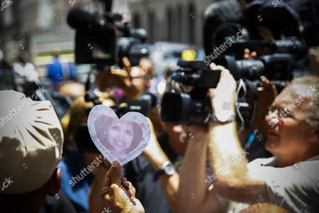 Cameramen Focus in on a Protestor Holding an Image of Murdered Anni Dewani As He Shouts in Protest Aginats the South African Justice System Outside the Western Cape High Court Cape Town South Africa 08 December 2014 Judge Jeanette Traverso Dismissed the Case Against Shrien Dewani who was Accused of Masterminding the Murder of His Wife Anni During a Staged Car-jacking on Their 2010 Honeymoon Judge Traverso Said the Evidence Presented by the Prosecution Fell 'Far Below the Threshold' of what a Reasonable Court Could Convict on South Africa Cape Town