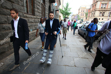 Brother of South African Paralympian Oscar Pistorius Carl Pistorius Leaves the High Court in Pretoria October 13 2014 on the First Day of the Sentencing Phase of His Brother's Trial Pistorius was Founded Guilty of Culpable Homicide Charges For the Death of His Model Girlfriend Reeva Steenkamp who He Shot Through the Bathroom Door Inside His Pretoria Residence in February 2013 Carl Pistorius is in Recovery After a Recent Vehicle Accident Which Left Him Hospitalized For Nearly a Month South Africa Pretoria