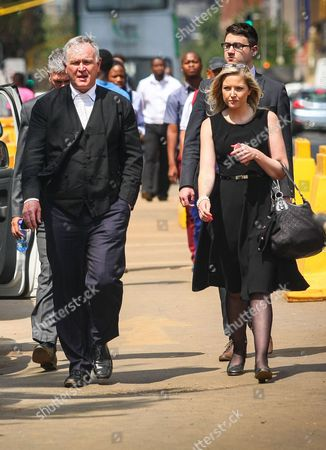 Oscar Pistorius' Leading Defence Counsel Barry Roux and Assistant Roxanne Adams Arrive at the High Court in Pretoria October 13 2014 For the First Day of the Sentencing Phase of the Paralympian's Murder Trial Pistorius was Found Guilty of the Culpable Murder of His Girlfriend Model Reeva Steenkamp on 14 February 2013 South Africa Pretoria