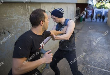 Tactical Kung Fu Training (tkt) Instructor Elan Lea From Los Angeles Usa (l) Practices a Gun Take Down Technique in an Alleyway Outside the Chinese Martial Arts and Health Centre in Cape Town South Africa 17 September 2014 Tkt is a Self-defense System Developed For Modern Day Close Quarter Real Life Situations Developed From Traditional Chinese Martial Arts Systems It Condenses That Knowledge to Guide Students Through a Practical Curriculum of Techniques Application and Pshycology Covering Gun Knife and Unarmed Situations As Well As Teaching Situational Awareness and Avoidance South Africa Has One of the Highest Violent Crime Rates in the World with Muggings Attacks and Rape a Daily Occurence the Tkt System is Designed to Address This Nationwide Problem and Train Practitioners Within a Few Months to Protect Themselves Against These Threats South Africa Cape Town
