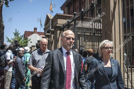 Arnold Pistorius (c) and Lois Pistorius (l) the Uncle and Aunt of South African Paralympic Athlete Oscar Pistorius Leaving the High Court in Pretoria South Africa 21 October 2014 Oscar Pistorius was Sentenced to 5 Years in Prison After Being Convicted of Culpable Homicide For His Part in the Shooting of His Model Girlfriend Reeva Steenkamp in February 2013 South Africa Pretoria