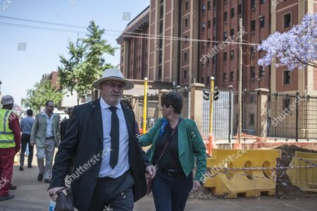 Henke Pistorius (l) the Father of South African Paralympic Athlete Oscar Pistorius Leaves the High Court in Pretoria South Africa 21 October 2014 Oscar Pistorius was Sentenced to 5 Years in Prison After Being Convicted of Culpable Homicide For His Part in the Shooting of His Model Girlfriend Reeva Steenkamp in February 2013 South Africa Pretoria