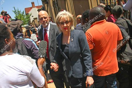 Arnold Pistorius (c-l) and Lois Pistorius (c-r) the Uncle and Aunt of South African Paralympic Athlete Oscar Pistorius Leaving the High Court in Pretoria South Africa 21 October 2014 Oscar Pistorius was Sentenced to 5 Years in Prison After Being Convicted of Culpable Homicide For His Part in the Shooting of His Model Girlfriend Reeva Steenkamp in February 2013 South Africa Pretoria