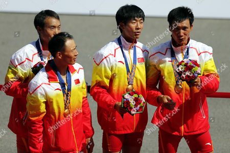 Chinese (from Left) Yu Chenggang Li Hui Fan Junjie and Wang Tiexin Pose with Their Gold Medals During the Victory Ceremony For the Rowing Lightweight Men's Quadruple Scull at Chungju Tageum Lake Rowing Centre During the Asian Games 2014 in Incheon South Korea 25 September 2014 Korea, Republic of Incheon