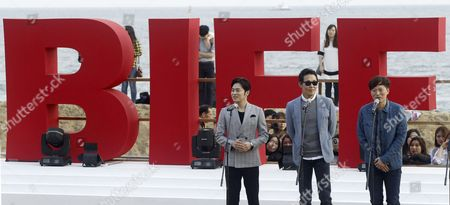 (l-r) South Korean Actors and Cast Members Jo Jung-suk Park Sung-woong and Jung Jae-young Attend the Outdoor Greeting For 'The Fatal Encounter' Movie at the 19th Busan International Film Festival (biff) at the Haeundae Biff Village in Busan South Korea 03 October 2014 the Film Festival One of the Most Significant in Asia Showcases 314 Films From 79 Countries From 02 to 11 October in Busan Korea, Rebublic of Busan