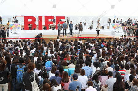 (l-r Background) South Korean Actors and Cast Members Jo Jung-suk Park Sung-woong and Jung Jae-young Attend the Outdoor Greeting For 'The Fatal Encounter' Movie at the 19th Busan International Film Festival (biff) at the Haeundae Biff Village in Busan South Korea 03 October 2014 the Film Festival One of the Most Significant in Asia Showcases 314 Films From 79 Countries From 02 to 11 October in Busan Korea, Rebublic of Busan