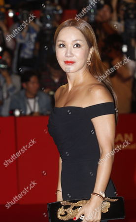 South Korean Singer and Actress Yum Jung-ah Arrives at the Opening Ceremony of the 19th Busan International Film Festival (biff) in Busan South Korea 02 October 2014 the Film Festival One of the Most Significant in Asia Will Showcase 314 Films From 79 Countries From 02 to 11 October Korea, Rebublic of Busan