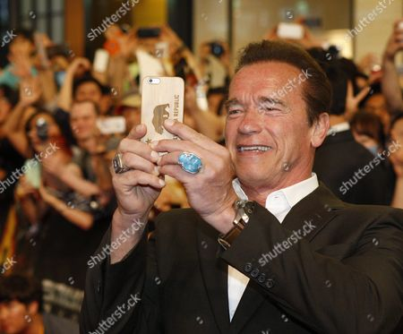 Stock Photo of Austrian-born Us Actor/cast Member Arnold Schwarzenegger Takes a Picture During the Premiere of the Movie 'Terminator Genisys' at Lotte World Mall in Seoul South Korea 02 July 2015 the Movie by Us Director Alan Taylor Will Open in South Korean Theaters on 02 July Korea, Rebublic of Seoul
