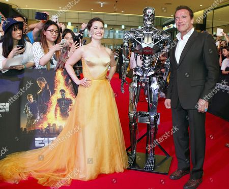 Stock Picture of British Actress/cast Member Emilia Clarke (l) and Austrian-born Us Actor/cast Member Arnold Schwarzenegger (r) Pose Next to the Film Character During the Premiere of the Movie 'Terminator Genisys' at Lotte World Mall in Seoul South Korea 02 July 2015 the Movie by Us Director Alan Taylor Will Open in South Korean Theaters on 02 July Korea, Rebublic of Seoul