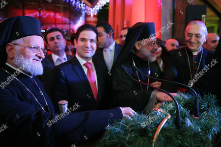 The Patriarch of Antioch and All the East Gregory Iii Laham (l) Attends an Event Held at Dama Rose Hotel Damascus Syria 17 December 2014 According to Local Reports the Event Also Marked the Occasion of Turning on Christmas Lights Syrian Arab Republic Damascus