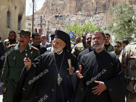 The Patriarch of the Melkite Greek Catholic Church Gregory Iii Laham (c) Attends an Official Ceremony Held at St Thecla Convent in Maaloula Syria 13 June 2015 According to Media Reports an Official Ceremony was Held at St Thecla Convent in Maaloula Syria to where a Number of Stolen Icons and Pieces Have Been Handed Over on 13 June 2015 the Stolen Pieces Were Restored From Lebanon and Include Three Pieces of a Bronze Statue of Jesus Christ Three Bells Icons and Religious Books Extremists Overran the Iconic Ancient Town Located Near Damascus in 2013 and Vandalized and Destroyed Parts of It Several Pieces and Icons Have Been Restored to Maaloula Gradually After the Army Recaptured the Town in April 2014 Epa/youssef Badawi Syrian Arab Republic Damascus