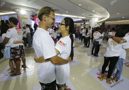 A Couple German Jens Hotze (c-l) 38 and Thai Siriporn Buakla (c-r) 36 Hug Each Other in an Attempt to Break the Guinness World Records For the Longest Marathon Hugging As Part of the Upcoming Valentine's Day Celebrations in Pattaya Chonburi Province Thailand 13 February 2014 Thirty-one Couples From Thailand and Abroad Took Part in the Contest the Current World Record For the Longest Hugging was Made by British Sanderson Jones and Mikey Lear in March 2013 Thailand Pattaya