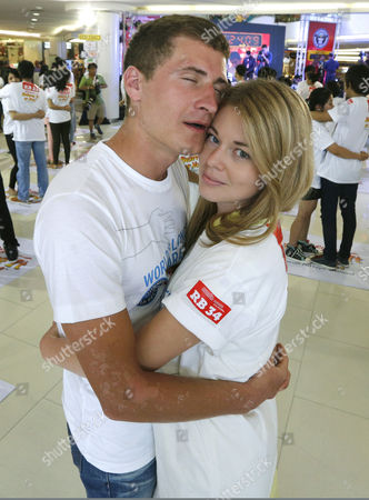Russian Nicolay Vlasov (l) 23 and His Partner Darya Ckuneva (r) 22 Hug Each Other in an Attempt to Break the Guinness World Records For the Longest Marathon Hugging As Part of the Upcoming Valentine's Day Celebrations in Pattaya Chonburi Province Thailand 13 February 2014 Thirty-one Couples From Thailand and Abroad Took Part in the Contest the Current World Record For the Longest Hugging was Made by British Sanderson Jones and Mikey Lear in March 2013 Thailand Pattaya
