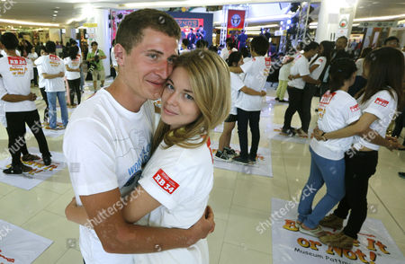 Russian Nicolay Vlasov (l) 23 and His Partner Darya Ckuneva (2-l) 22 Hug Each Other in an Attempt to Break the Guinness World Records For the Longest Marathon Hugging As Part of the Upcoming Valentine's Day Celebrations in Pattaya Chonburi Province Thailand 13 February 2014 Thirty-one Couples From Thailand and Abroad Took Part in the Contest the Current World Record For the Longest Hugging was Made by British Sanderson Jones and Mikey Lear in March 2013 Thailand Pattaya