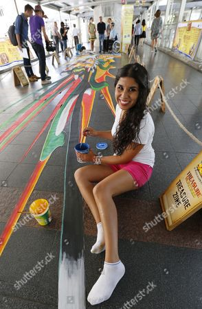 Street Artist Adriana Del Rocio Garcia Hernandez of Mexico Works on Her 3d Artwork on the Floor of Bangkok's Elevated Walkway Part of an International Street Art Festival Called 'Living Art Festival' at Ratchaprasong Shopping and Business District Highlighting 3d and 4d Arts in Bangkok Thailand 12 May 2014 There Are More Than 30 Artists Taking Part in the Annual Festival of Illusion Turning a Large Central Shopping District Into a Canvas All Under the Theme of 'Treasure Hunt' the Interactive Festival Runs Until 08 June Thailand Bangkok