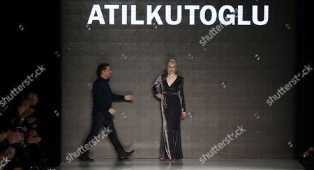 Austrian Model Larissa Marolt (r) and Turkish Designer Atil Kutoglu Cheers Visitors After a Fashion Show During the Istanbul Mercedes-benz Fashion Week in Istanbul Turkey 10 March 2014 the Event Presents Fall-winter 2014 Collections From 10 to 14 March Turkey Istanbul