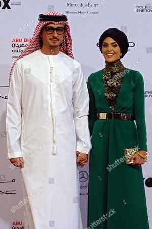 Stock Picture of Emirati Film Maker Ali Mostafa and His Wife Maha Arrive For the Opening Ceremony of the Abu Dhabi Film Festival (adff) 2014 in Abu Dhabi United Arab Emirates 23 October 2014 the Festival Runs From 23 October to 01 November United Arab Emirates Abu Dhabi