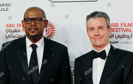 Stock Picture of American Actor Producer and Director Forest Whitaker (l) and Ceo of Jaeger-lecoultre Daniel Riedo (r) Arrive at the Red Carpet For the Opening Ceremony of the Abu Dhabi Film Festival (adff 2013) in Abu Dhabi United Arab Emirates 24 October 2013 United Arab Emirates Abu Dhabi
