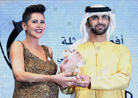 Egyptian Actress Yasmine Raees (l) Receives From Sheikh Mansour Bin Mohammed Bin Rashid Al Maktoum (r) the Award of Best Actress at Muhr Arab Feature For Her Movie 'Fatat El-masnaa(factory Girl)' During the Muhr Awards Ceremony of the 10th Dubai International Film Festival (diff) 2013 in Gulf Emirate of Dubai United Arab Emirates 13 December 2013 United Arab Emirates Dubai
