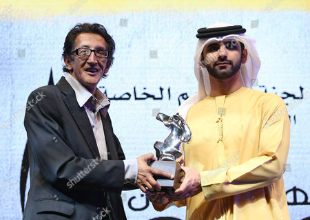 Actor Hassan Ben Badida (l) in Behalf of Nabil Ayouch Receives the Special Jury Prize From Sheikh Mansour Bin Mohammed Bin Rashid Al Maktoum For Muhr Arab Feature For the Movie 'C'est Eux Les Chiens (they Are the Dogs)' During the Muhr Awards Ceremony at the 10th Dubai International Film Festival (diff) 2013 in Gulf Emirate of Dubai United Arab Emirates 13 December 2013 United Arab Emirates Dubai