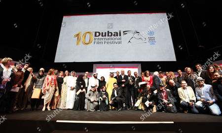 Sheikh Mansour Bin Mohammed Bin Rashid Al Maktoum (c-back) Stands with the Winners During the Muhr Awards Ceremony at the 10th Dubai International Film Festival (diff) 2013 in Gulf Emirate of Dubai United Arab Emirates 13 December 2013 United Arab Emirates Dubai