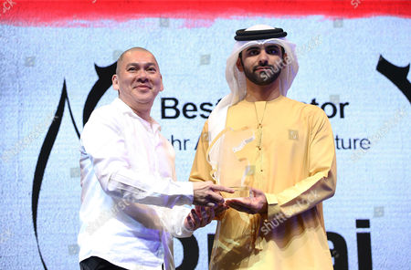 Tsai Ming Liang (l) Receives From Sheikh Mansour Bin Mohammed Bin Rashid Al Maktoum (r) the Award of Best Director at Muhr Arab Feature For His Movie 'Jiao You (stray Dogs)' During the Muhr Awards Ceremony of the 10th Dubai International Film Festival (diff) 2013 in Gulf Emirate of Dubai United Arab Emirates 13 December 2013 United Arab Emirates Dubai