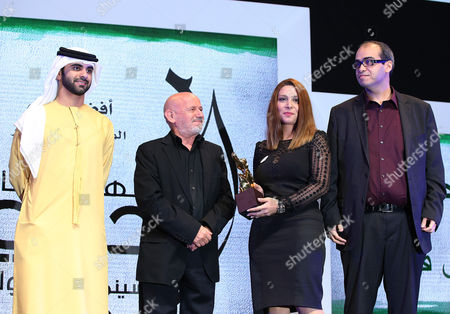 Bavi Yassin (2-r) and Nore Maatala (r) Receive From Sheikh Mansour Bin Mohammed Bin Rashid Al Maktoum (l) the Award of Best Film at Muhr Arab Shorts For the Movie 'De Verloren Stem(the Lost Voice)' During the Muhr Awards Ceremony of the 10th Dubai International Film Festival (diff) 2013 in Gulf Emirate of Dubai United Arab Emirates 13 December 2013 United Arab Emirates Dubai
