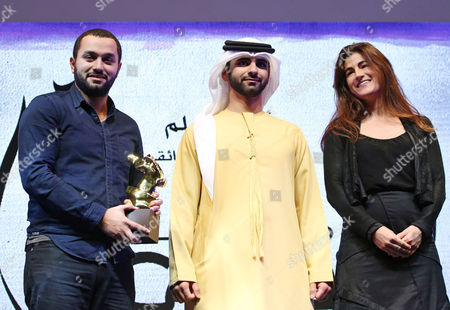 Al-midan's Producer Karim Amer (l) and Director Jehane Noujaim (r) Receive From Sheikh Mansour Bin Mohammed Bin Rashid Al Maktoum (c) the Award of Best Film at Muhr Arab Documentary For the Movie 'Al-midan (the Square)' During the Muhr Awards Ceremony of the 10th Dubai International Film Festival (diff) 2013 in Gulf Emirate of Dubai United Arab Emirates 13 December 2013 United Arab Emirates Dubai