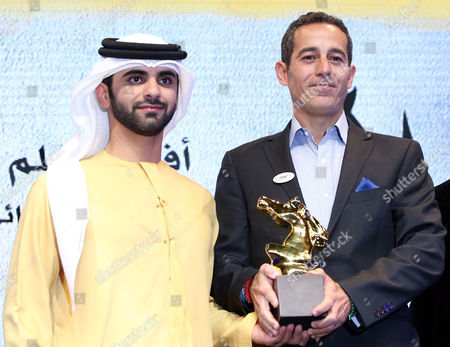 Waleed Zuaiter (r) Receives From Sheikh Mansour Bin Mohammed Bin Rashid Al Maktoum (l) the Award of Best Film For Muhr Arab Feature For the Movie 'Omar' During the Muhr Awards Ceremony at the 10th Dubai International Film Festival (diff) 2013 in Gulf Emirate of Dubai United Arab Emirates 13 December 2013 United Arab Emirates Dubai