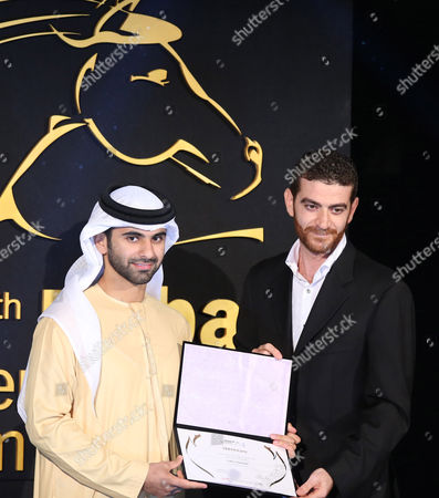 Palestinian-jordanian Writer Director and Producer Yahya Alabdallah (r) Receives From Sheikh Mansour Bin Mohammed Bin Rashid Al Maktoum (l) the Award For Special Mention For the Film 'Al-majls' (the Council) During the Muhr Awards Ceremony of the 11th Dubai International Film Festival (diff) 2014 in Gulf Emirate of Dubai United Arab Emirates 16 December 2014 the Diff Runs From 10 to 17 December United Arab Emirates Dubai