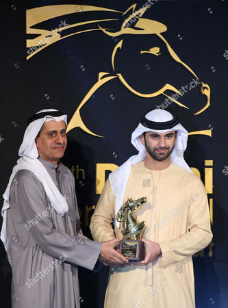 An Unidentified Man (l) on Behalf of Uae Film Director Nujoom Al Ghanem Receives From Sheikh Mansour Bin Mohammed Bin Rashid Al Maktoum (r) the Award For Best Non-fiction Film 'Samma Qarrebah' (nearby Sky) During the Muhr Awards Ceremony of the 11th Dubai International Film Festival (diff) 2014 in Gulf Emirate of Dubai United Arab Emirates 16 December 2014 the Diff Runs From 10 to 17 December United Arab Emirates Dubai