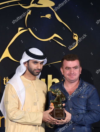 Iraqi-kurdish Sahim Omar Kalifa (r) Receives From Sheikh Mansour Bin Mohammed Bin Rashid Al Maktoum (l) the Award of Best Jury Prize of 'Muhr Shorts' For the Movie 'The Deebad Hunter' During the Muhr Awards Ceremony of the 11th Dubai International Film Festival (diff) 2014 in Gulf Emirate of Dubai United Arab Emirates 16 December 2014 the Diff Runs From 10 to 17 December United Arab Emirates Dubai