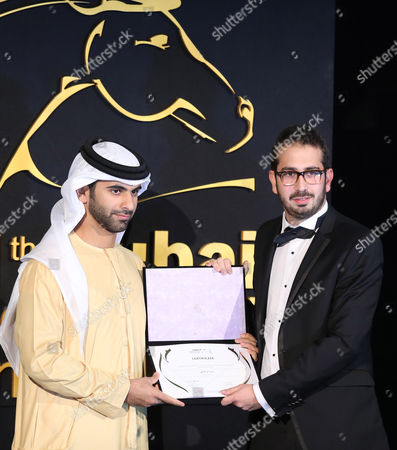 Lebanese Karim Rahbani (r) Receives From Sheikh Mansour Bin Mohammed Bin Rashid Al Maktoum (r) the Award of Special Mention in the Category 'Muhr Shorts' For 'With Thy Spirit' During the Muhr Awards Ceremony of the 11th Dubai International Film Festival (diff) 2014 in Gulf Emirate of Dubai United Arab Emirates 16 December 2014 the Diff Runs From 10 to 17 December United Arab Emirates Dubai