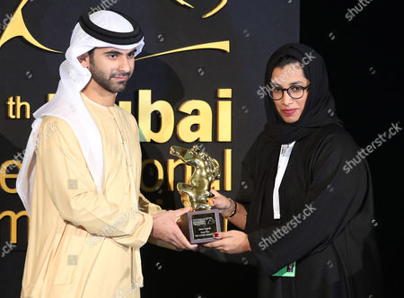 Uae's Aisha Alzaabi (r) Receives From Sheikh Mansour Bin Mohammed Bin Rashid Al Maktoum (r) the Award For Best Film in the Category 'Muhr Shorts' For Movie 'Al Buad Al Akhar' (the Other Dimension) During the Muhr Awards Ceremony of the 11th Dubai International Film Festival (diff) 2014 in Gulf Emirate of Dubai United Arab Emirates 16 December 2014 the Diff Runs From 10 to 17 December United Arab Emirates Dubai