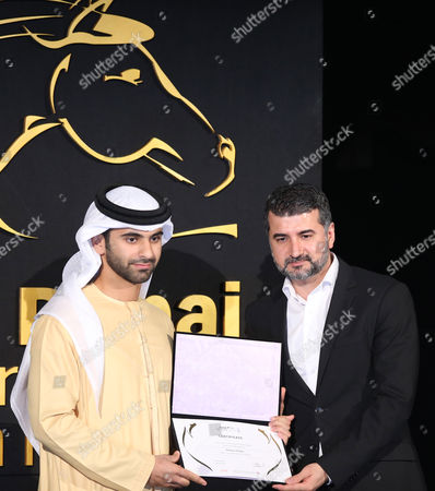 Kurdish-norwegian Filmmaker Hisham Zaman (r) Receives From Sheikh Mansour Bin Mohammed Bin Rashid Al Maktoum (l) the Award For Special Mention For Film 'Brev Til Kongen' (letter to the King) During the Muhr Awards Ceremony of the 11th Dubai International Film Festival (diff) 2014 in Gulf Emirate of Dubai United Arab Emirates 16 December 2014 the Diff Runs From 10 to 17 December United Arab Emirates Dubai