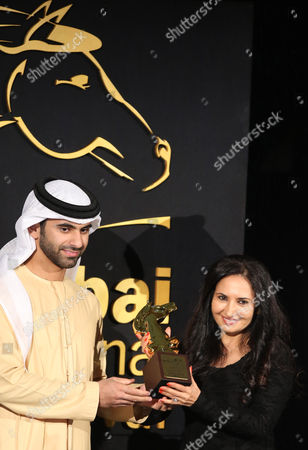 Yemeni Film Producer Khadija Al-salami (r) Receives From Sheikh Mansour Bin Mohammed Bin Rashid Al Maktoum (l) the Award For Best Fiction Film 'Ana Nojoom Bent Alasherah Wamotalagah' (i Am Nojoom Age 10 and Divorced) During the Muhr Awards Ceremony of the 11th Dubai International Film Festival (diff) 2014 in Gulf Emirate of Dubai United Arab Emirates 16 December 2014 the Diff Runs From 10 to 17 December United Arab Emirates Dubai