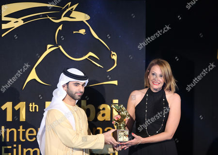 Tunisian Director Hinde Boujemaa (r) Receives From Sheikh Mansour Bin Mohammed Bin Rashid Al Maktoum (l) the Award of Best Film in the Category 'Muhr Shorts' For Her Movie 'Et Romeo Epousa Juliette' ( and Romeo Married Juliette) During the Muhr Awards Ceremony of the 11th Dubai International Film Festival (diff) 2014 in Gulf Emirate of Dubai United Arab Emirates 16 December 2014 the Diff Runs From 10 to 17 December United Arab Emirates Dubai