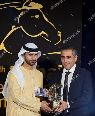 Palestinian Director Salam Abu Jabal (r) Receives From Sheikh Mansour Bin Mohammed Bin Rashid Al Maktoum (l) the Award For Best Jury Prize For the Film 'Roshmia' During the Muhr Awards Ceremony of the 11th Dubai International Film Festival (diff) 2014 in Gulf Emirate of Dubai United Arab Emirates 16 December 2014 the Diff Runs From 10 to 17 December United Arab Emirates Dubai