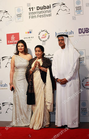 From (l-r) Sivani Pandey Managing Director Diff Indian Singer Asha Bhosle and Abdul Hamid Juma Chairman Diff Arrive at the Opening Ceremony of the 11th Dubai International Film Festival (diff) 2014 in the Gulf Emirate of Dubai United Arab Emirates 10 December 2014 the Diff Runs From 10 to 17 December Bhosle Will Be Honoured with the Lifetime Achievement Award United Arab Emirates Dubai