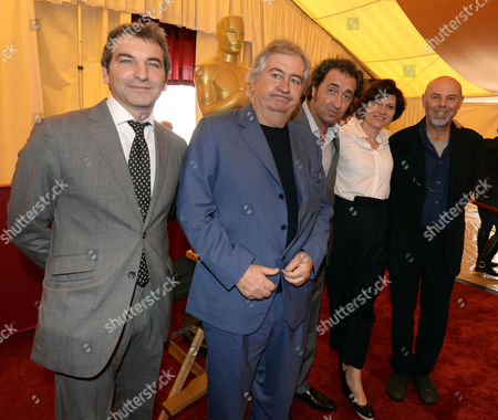 (l-r) Producer Nicola Giuliano Screenwriter Umberto Contrarello Italian Director Paolo Sorrentino Producer Francesca Cima and an Unidentified Crew Member of the Nominated Movie 'The Great Beauty' Pose at a Photocall of the Foreign Language Film Nominees of the 86th Annual Academy Awards in Hollywood Los Angeles California Usa 28 February 2014 the Oscars Which Honors the Best in Filmmaking Will Take Place 02 March United States Hollywood