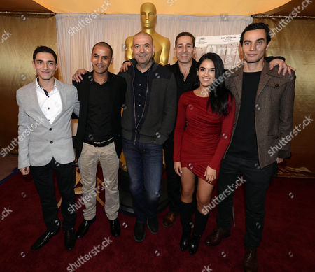 (l-r) Actors Samer Bisharat Iyad Hoorani Palestinian Director Hany Abu-assad Producer Waleed Zuaiter Actress Leem Lubany and Actor Adam Bakri of the Nominated Movie 'Omar' Pose at a Photocall of the Foreign Language Film Nominees of the 86th Annual Academy Awards in Hollywood Los Angeles California Usa 28 February 2014 the Oscars Which Honors the Best in Filmmaking Will Take Place 02 March United States Hollywood