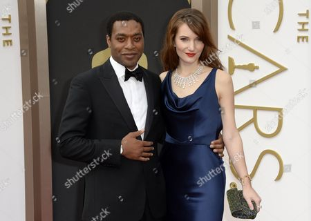 British Actor Chiwetel Ejiofor (l) and Wife Sari Mercer (r) Arrive For the 86th Annual Academy Awards Ceremony at the Dolby Theatre in Hollywood California Usa 02 March 2014 the Oscars Are Presented For Outstanding Individual Or Collective Efforts in Up to 24 Categories in Filmmaking United States Hollywood