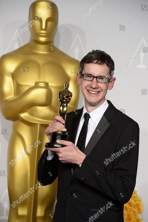 British Composer Steven Price Holds His Award For Best Original Score For 'Gravity' in the Press Room During the 86th Annual Academy Awards Ceremony at the Dolby Theatre in Hollywood California Usa 02 March 2014 the Oscars Are Presented For Outstanding Individual Or Collective Efforts in Up to 24 Categories in Filmmaking United States Hollywood